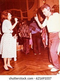 USSR, LENINGRAD - CIRCA 1988: Vintage photo of vintage couple dancing in Hotel Europe restaurant in Leningrad, USSR