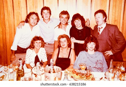 USSR, LENINGRAD - CIRCA 1988: Vintage photo of group of friends celebrating birthday in restaurant of hotel Europe in Leningrad, USSR