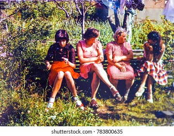 USSR, LENINGRAD, GORELOVO - CIRCA 1985: Vintage photo of group of women on garden bench