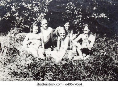 USSR, LENINGRAD, SESTRORETSK - CIRCA 1952: Vintage photo of group of young couples in outdoors picnic in Sestroretsk, Leningrad, USSR