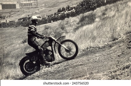 USSR, Russia - CIRCA 1960s: An antique Black & White photo of a Motorcyclist on the competition at motorcycle race.