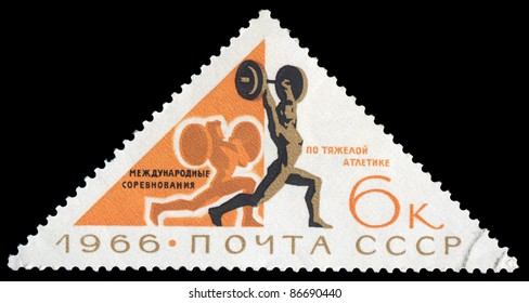 USSR (RUSSIA) - CIRCA 1966 : The post stamp printed in the Soviet Union shows a weight lifter in international competitions in weightlifting, circa 1966