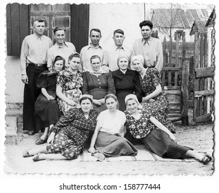 USSR, Ukraine - CIRCA, 1940s: Portrait of a big family - several generations of relatives in the village, near the house.