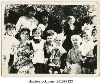 USSR, Ukraine - CIRCA 1950s: Group portrait of school pupils in uniforms.