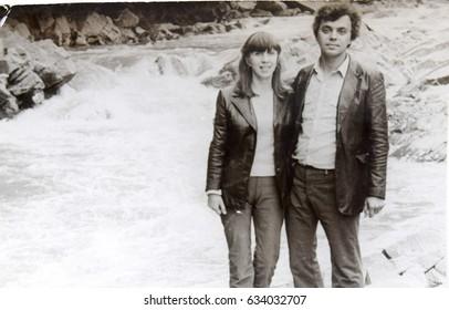 USSR, WESTERN UKRAINE, CARPATHIAN MOUNTAINS - CIRCA 1982: Vintage photo of couple at mountain wild river in Western Ukraine, Carpathian mountain river, USSR