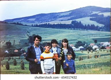 USSR, WESTERN UKRAINE, CARPATHIAN MOUNTAINS - CIRCA 1982: Vintage photo of soviet family portrait at Carpathian mountains landscape in Western Ukraine, USSR