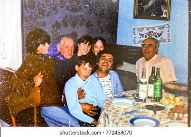 USSR, WESTERN UKRAINE, DOLISHNEE VILLAGE - CIRCA 1982: Vintage photo of feast relatives in ukrainian village house in Dolishee, Western Ukraine, USSR