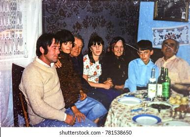 USSR, WESTERN UKRAINE, DOLISHNEE VILLAGE - CIRCA 1983: Vintage photo of family photo in ukrainian village house in Western Ukraine, USSR