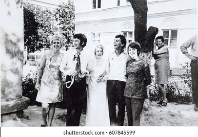 USSR, WESTERN UKRAINE, LVOV - CIRCA 1972: Vintage photo of happy soviet newly married with friends on wedding in Lvov, Western Ukraine, USSR