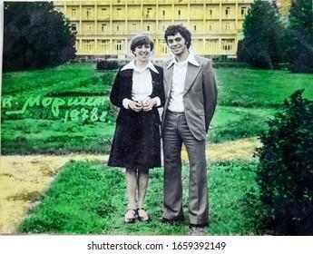 """USSR, WESTERN UKRAINE, MORSHIN - CIRCA 1976: Vintage photo of happy couple smiling. Nikolay and Lyudmila Tsyukevitch. Inscription on photo: """"Morshin, 1976""""."""