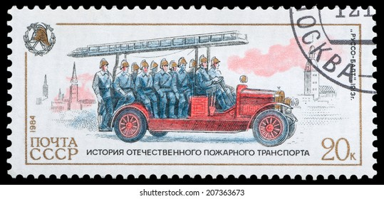 USSR-CIRCA 1984: A post stamp printed in USSR show firemen Russo-Balt , devoted history of fire transport, circa 1984.