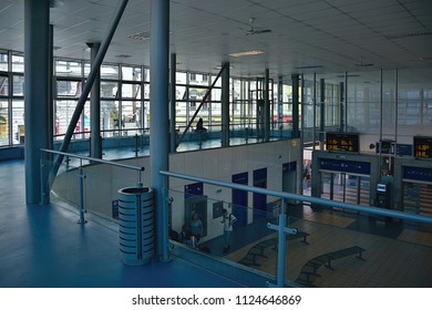 Usti nad Labem, Czech republic - June 30, 2018: Vestibule of main train station Usti nad Labem with benchs, informations displays and people during summer day
