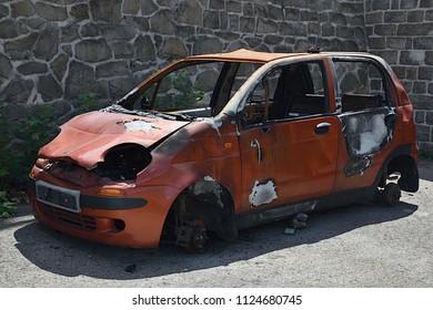 Usti nad Labem, Czech republic - June 30, 2018: abandoned red car Daewoo Matiz after fire stand in Dresden street in czech city of Usti nad labem during summer day