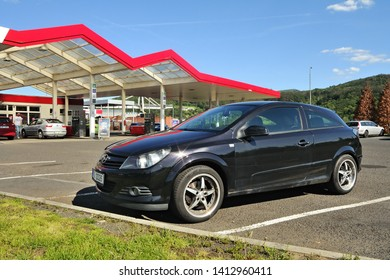 Usti nad Labem, Czech republic - May 30, 2019: black car Opel Astra stand on filling station of Benzina company