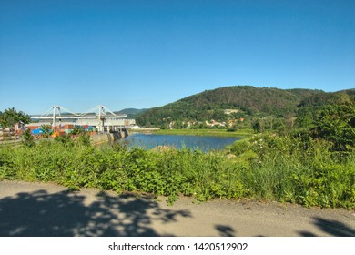 Usti nad Labem, Czech republic - June 03, 2019: Lagoon, flowers, houses and hill in valley of Labe river in czech republic