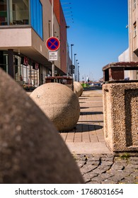 Usti nad Labem / Czech Republic - 04.23.2020: Decorative concrete balls in the city, also serving as a traffic barrier near the fast food restaurant KFC