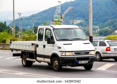 USTI NAD LABEM, CZECH REPUBLIC - JULY 21, 2014: White cargo truck Iveco Daily in the city street.