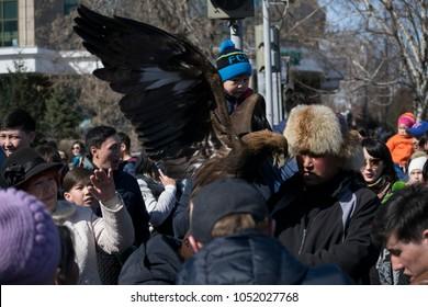 Ust-Kamenogorsk, East Kazakhstan, Kazakhstan - 03.22.2018: Mass celebration of the national Kazakh holiday Nauryz. the hunter with the eagle.