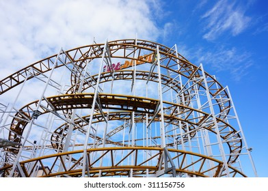 USTRONIE MORSKIE, POLAND - JULY 20, 2015: Rollercoaster at a fair on the center of the town