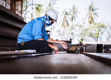 UT, Ultrasonic testing to detect imperfection or defect in welding of steel structure outside. NDT Inspection.