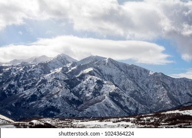 utah landscape of mountain peaks and pine trees after snowstorm near ski resort near ogden