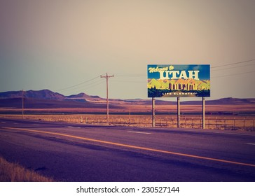utah state line welcome sign with open landscape with retro instagram filter