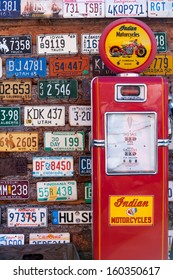 UTAH, USA - NOVEMBER 16: Various old American license plates behind antique gas pump on November 16, 2008. Gas station along the rural road in Utah