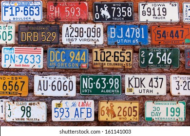 UTAH, USA - NOVEMBER 16: Various old American license plates behind antique gas pump on November 16, 2008. License plates are from various American states.
