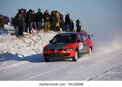 "UTENA, LITHUANIA - JANUARY 28: MR Sport team Mitsubishi Lancer car during ""Halls Winter Rally 2012"", on January 28, 2012 in Utena, Lithuania"