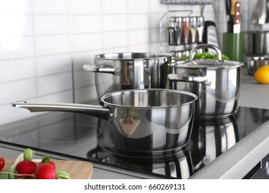 Utensils for cooking classes on electric stove in kitchen