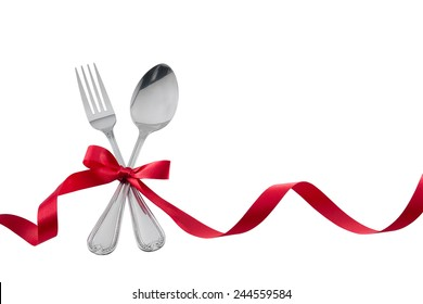 Utensils Fork Spoon with Red Ribbon isolated on white with clipping path