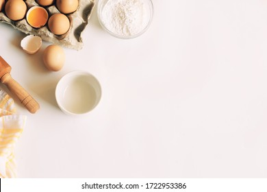 utensils and ingredients for cake preparation. on a white table.  isolated.
