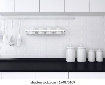 Utensils and kitchenware on the worktop. Black and white kitchen design.