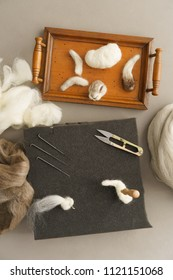 Utensils for needle felting a wild rabbit with sheep wool