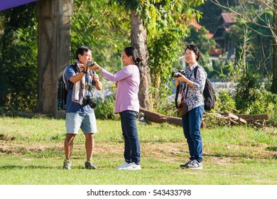 Uthai Thani, Thailand - December, 17, 2016 : Unidentified Photographer taking pictures with camera Wat Uposatharam Temple,Located along the banks of the Sakae Krang River in Uthai Thani, Thailand.
