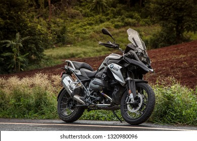 UTHAITHANI,THAILAND-JULY 8,2017 : BMW R 1200 GS above the line at the road morning sunrise BMW Trip ON JULY 8,2017 IN UTHAITHANI THAILAND