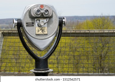 Utica, New York - APR 29, 2019: A Coin Operated Tower Optical Viewer on the Observation Deck of Utica Zoo.