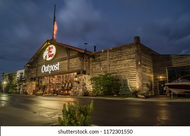 Utica, New York, USA - SEPTEMBER 3, 2018: Bass Pro Shops exterior sign and logo during night. Bass Pro Shops is a retailer of hunting, fishing, camping and related outdoor merchandise.