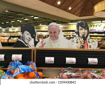 Utica, NY, USA, January 1, 2019: Frank Sinatra, The Pope and Elvis cardboard cutouts at a grocery store