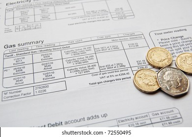 utility bill and coins for payment