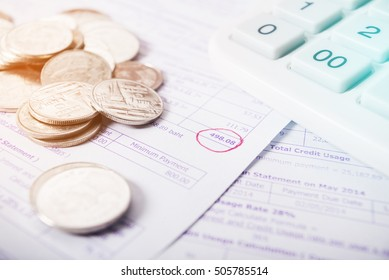Utility bill with silver coins and calculator save money concept filter color style