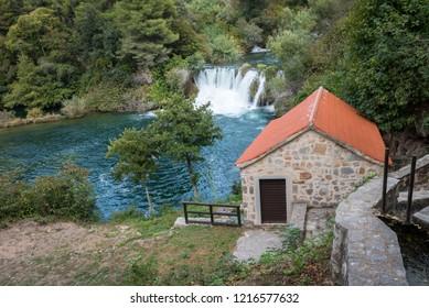 Utility house near the waterfall in the national park near the town of Skradin, Croatia