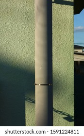 Utility pole and green outer wall