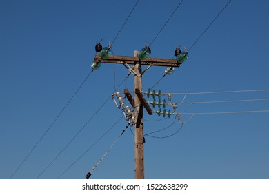 A utility pole or telegraph pole used to support street lights, power lines, electrical cable and other public utilities