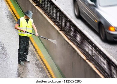 utility professional worker for cleaning with power water