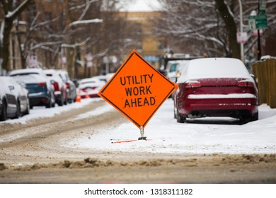 Utility Work Ahead sign. Winter time.