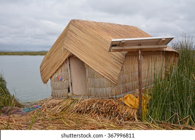 The utilization of solar power to gather alternative energy power from the sun to generate electricity in the rural reed houses of the Uros island on Lake Titicaca, Puno, Peru.