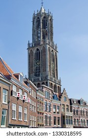 Utrecht, Holland - July 10, 2015: Church tower of Utrecht cathedral above a shopping street along a canal in Utrecht, Holland on July 10, 2015