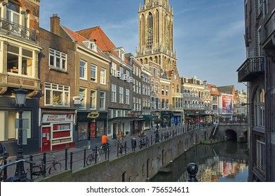 UTRECHT, HOLLAND, JUNE, 14, 2017: Summer view on European old classic buildings houses, church, city water channel and walking people. European classical architecture buildings houses tours vacations