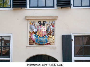 Utrecht / Netherlands - 06 11 2018: The Latin motto: Concordia res parvae crescunt on a shield hanging on the wall of a historical house called the Head guard at the Janskerkhof in Utrecht.